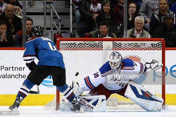 Tyson Barrie of the Colorado Avalanche scores the game winning goal against goalie Henrik Lundqvist of the New York Rangers in an overtime shootout...