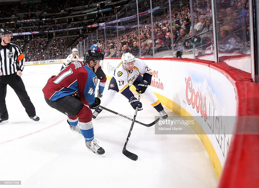 Tyson Barrie #41 of the Colorado Avalanche skates against <a gi-track='captionPersonalityLinkClicked' href=/galleries/search?phrase=Patric+Hornqvist&family=editorial&specificpeople=1966879 ng-click='$event.stopPropagation()'>Patric Hornqvist</a> #27 of the Nashville Predators at the Pepsi Center on February 18, 2013 in Denver, Colorado.