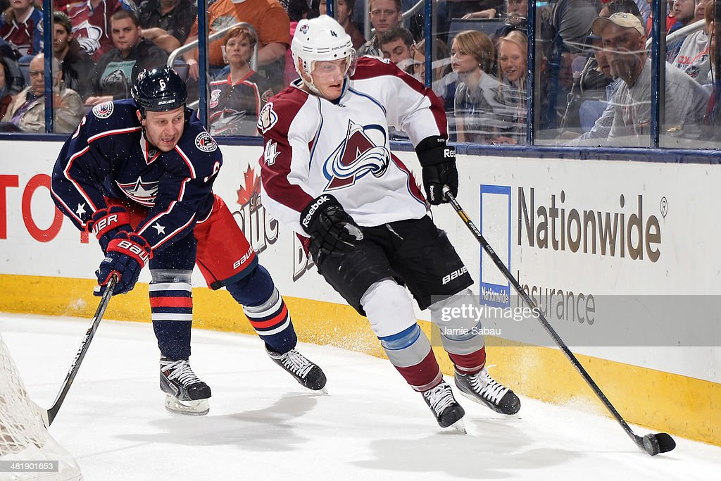 Tyson Barrie #4 of the Colorado Avalanche skates the puck behind the net trailed by Nikita Nikitin #6 of the Columbus Blue Jackets during the second period on April 1, 2014 at Nationwide Arena in Columbus, Ohio.