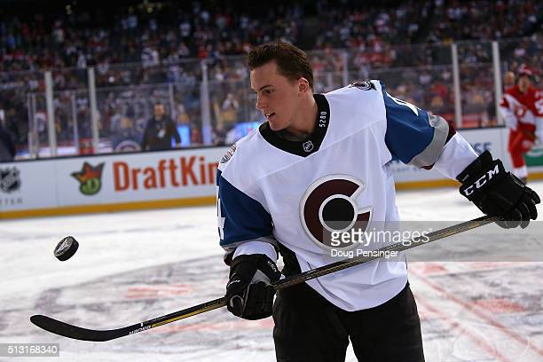 Tyson Barrie of the Colorado Avalanche tosses the puck as he warms up prior to facing the Colorado Avalanche 2016 Coors Light Stadium Series at Coors...