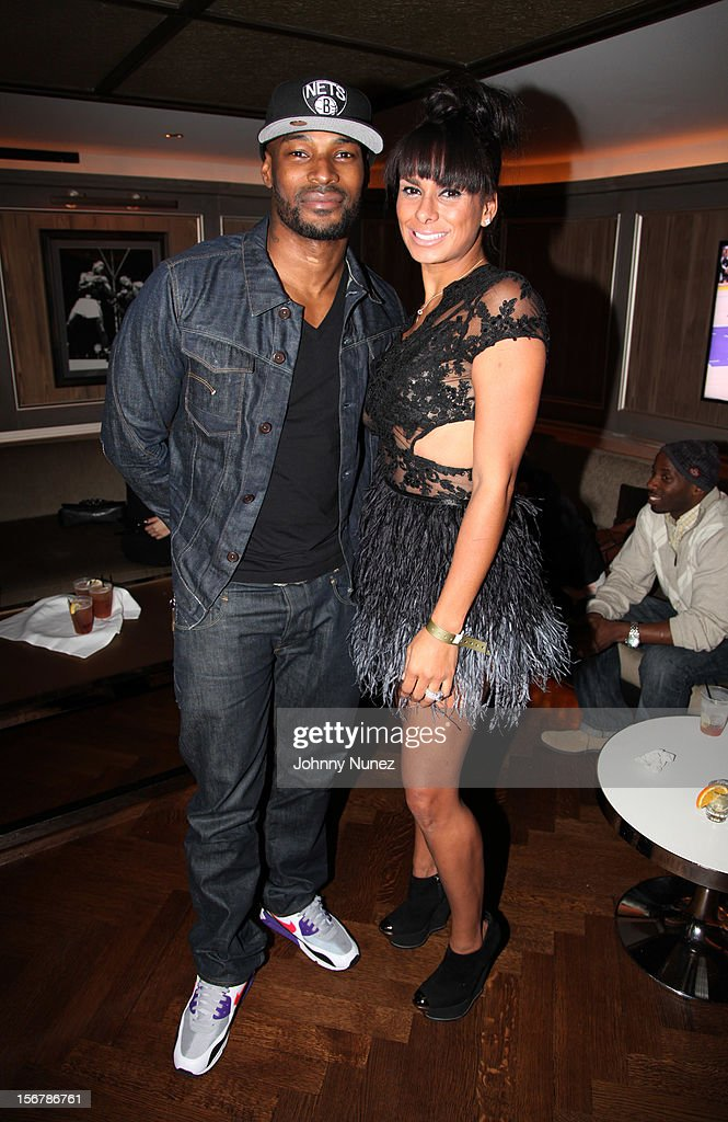 Tyson Beckford and Laura Govan attend Rihanna's 'Unapologetic' Record Release Party at 40 / 40 Club on November 20, 2012 in New York City.