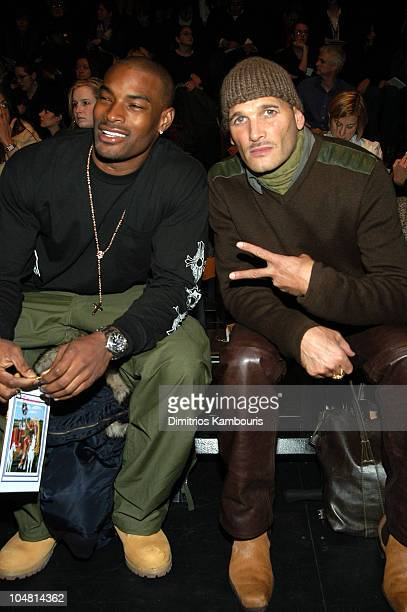 Tyson Beckford and Phillip Bloch during MercedesBenz Fashion Week Fall 2003 Collections Betsey Johnson Front Row at Bryant Park in New York City New...
