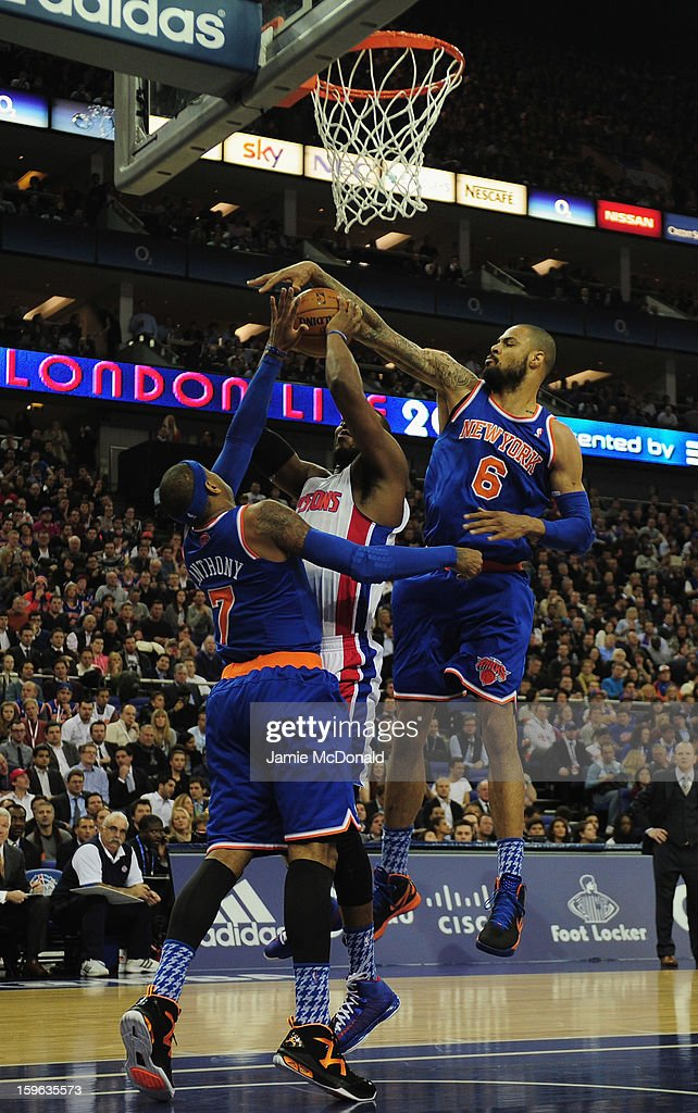 Tyson Chandler and Carmelo Anthony of New York Knicks tries to block the shot from Will Bynum of Detroit Pistons during the NBA London Live 2013 game between New York Knicks and the Detroit Pistons at the O2 Arena on January 17, 2013 in London, England.