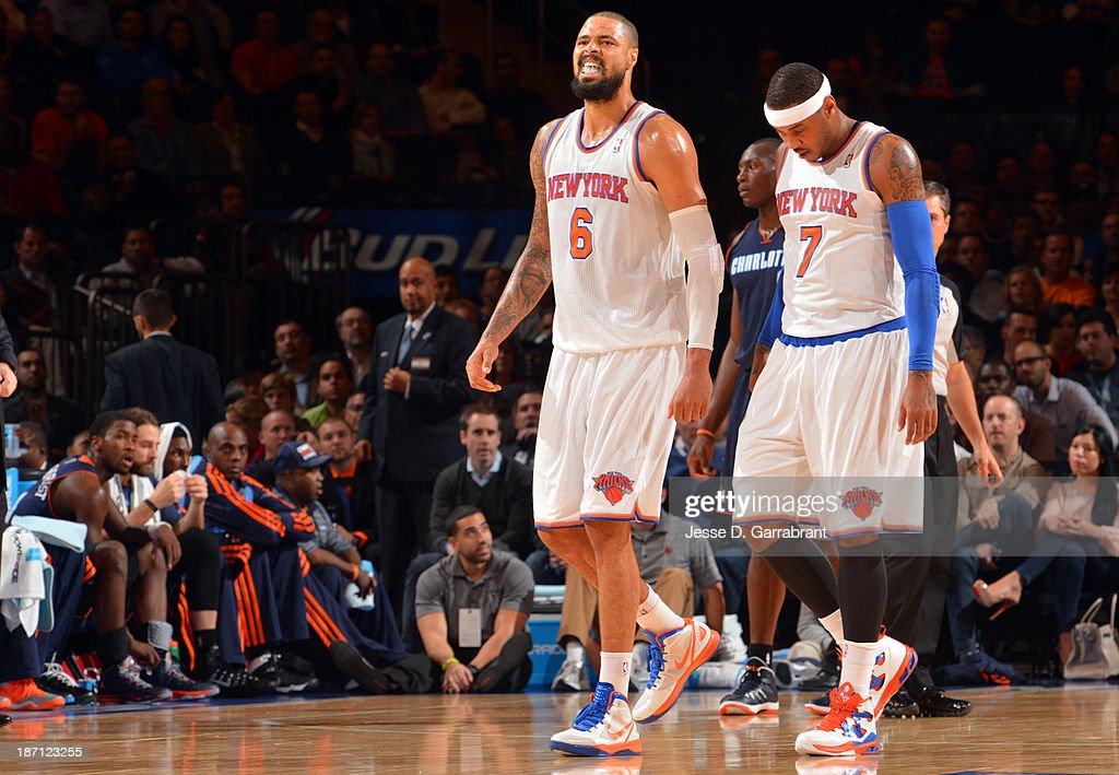 Tyson Chandler #6 and Carmelo Anthony #7 of the New York Knicks walk on the court against the Charlotte Bobcats during the game on November 5, 2013 at Madison Square Garden in New York City, New York.