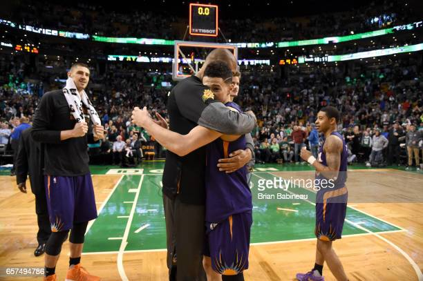 Tyson Chandler and Devin Booker of the Phoenix Suns hug after Devin Booker scores 70 points against the Boston Celtics on March 24 2017 at the TD...