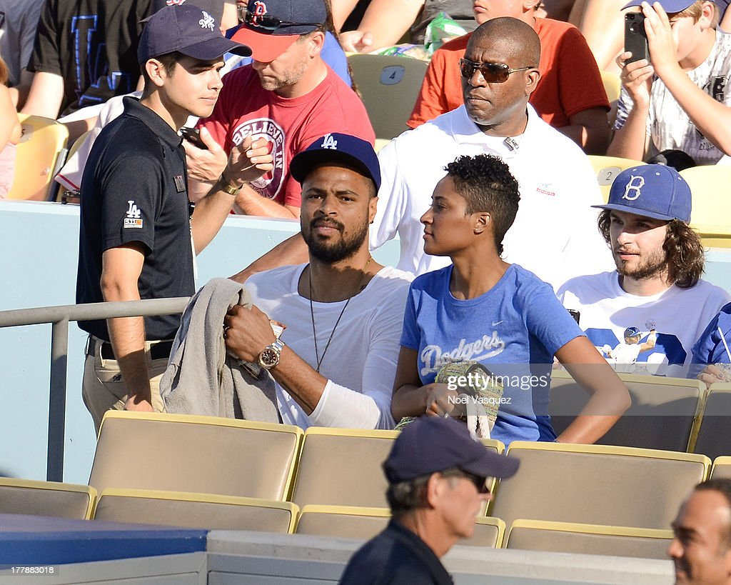 <a gi-track='captionPersonalityLinkClicked' href=/galleries/search?phrase=Tyson+Chandler&family=editorial&specificpeople=202061 ng-click='$event.stopPropagation()'>Tyson Chandler</a> (L) and his wife Kimberly Chandler attend a baseball game between the Boston Red Sox and the Los Angeles Dodgers at Dodger Stadium on August 25, 2013 in Los Angeles, California.
