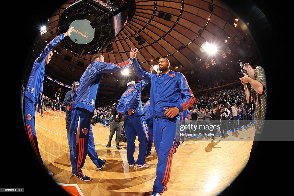 <a gi-track='captionPersonalityLinkClicked' href=/galleries/search?phrase=Tyson+Chandler&family=editorial&specificpeople=202061 ng-click='$event.stopPropagation()'>Tyson Chandler</a> #6 and <a gi-track='captionPersonalityLinkClicked' href=/galleries/search?phrase=Steve+Novak&family=editorial&specificpeople=693015 ng-click='$event.stopPropagation()'>Steve Novak</a> #16 of the New York Knicks shakes hands before a game played against the Minnesota Timberwolves on December 23, 2012 at Madison Square Garden in New York City.