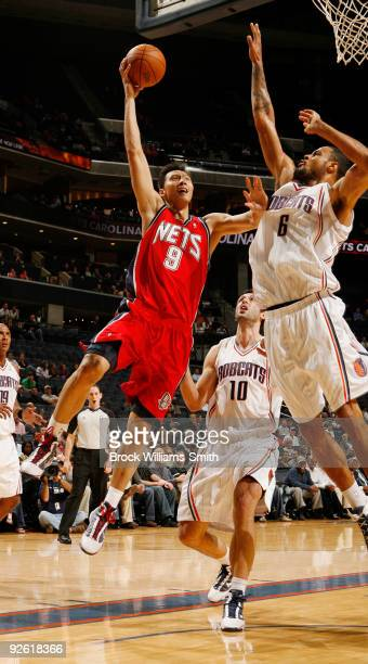 Tyson Chandler of the Charlotte Bobcats blocks against Yi Jianlian of the New Jersey Nets on November 2 2009 at the Time Warner Cable Arena in...