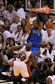 Tyson Chandler of the Dallas Mavericks dunks the ball against Joel Anthony of the Miami Heat in the first half in Game One of the 2011 NBA Finals at...