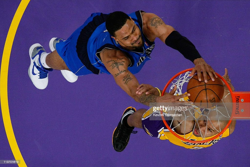 <a gi-track='captionPersonalityLinkClicked' href=/galleries/search?phrase=Tyson+Chandler&family=editorial&specificpeople=202061 ng-click='$event.stopPropagation()'>Tyson Chandler</a> #6 of the Dallas Mavericks dunks the ball over <a gi-track='captionPersonalityLinkClicked' href=/galleries/search?phrase=Derek+Fisher&family=editorial&specificpeople=201724 ng-click='$event.stopPropagation()'>Derek Fisher</a> #2 of the Los Angeles Lakers in Game Two of the Western Conference Semifinals in the 2011 NBA Playoffs at Staples Center on May 4, 2011 in Los Angeles, California.