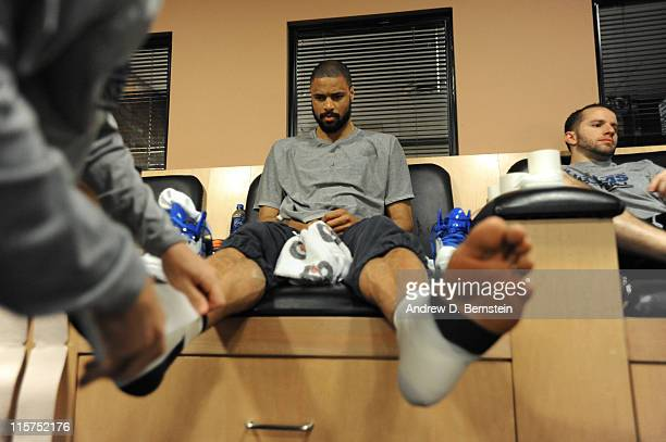 Tyson Chandler of the Dallas Mavericks has his ankles taped prior to Game Five of the 2011 NBA Finals against the Miami Heat on June 9 2011 at the...