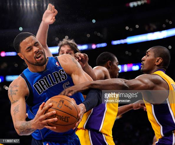 Tyson Chandler of the Dallas Mavericks has the ball as he goes up against Pau Gasol Andrew Bynum and Ron Artest of the Los Angeles Lakers in the...