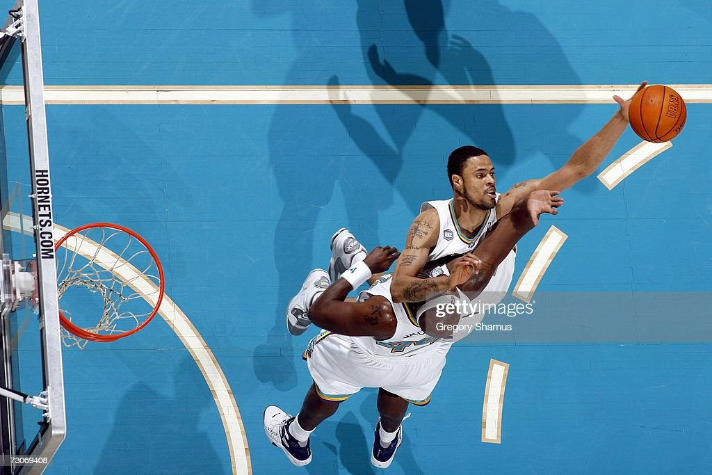 Tyson Chandler #6 of the New Orleans/Oklahoma City Hornets moves for the ball as he collides with teammate Marc Jackson #44 during the game against the Detroit Pistons on January 4, 2007 at the Ford Center in Oklahoma City, Oklahoma.
