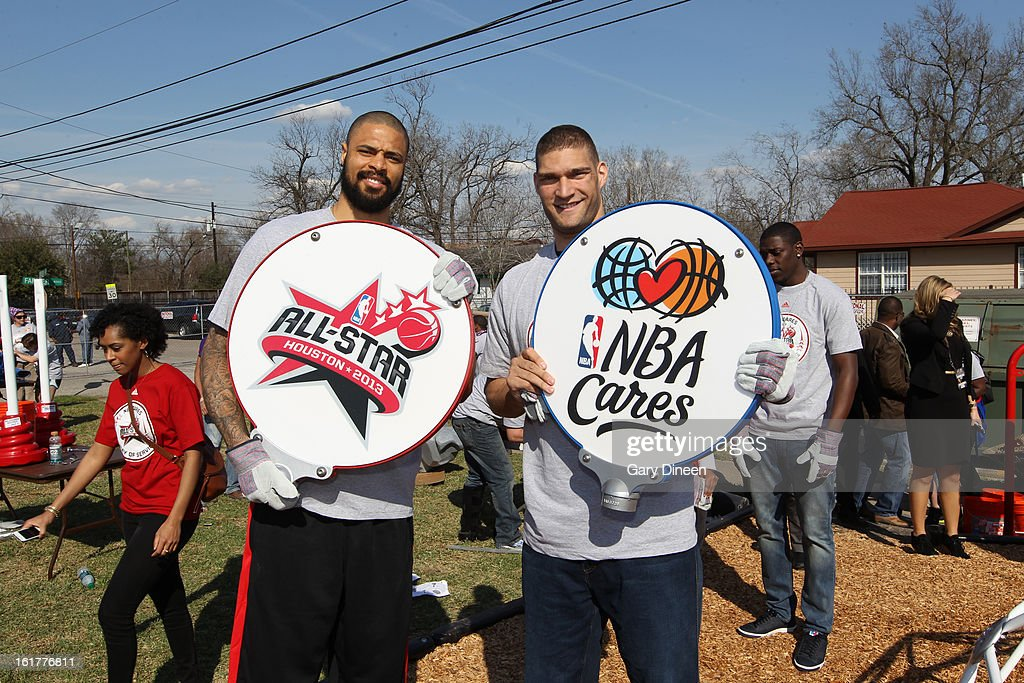 Tyson Chandler #6 of the New York Knicks and Brook Lopez #11 of the Brooklyn Nets hold up the All-Star and NBA Cares signs at the 2013 NBA Cares Day of Service at the Playground Build with KaBOOM! on February 15, 2013 in Houston, Texas.