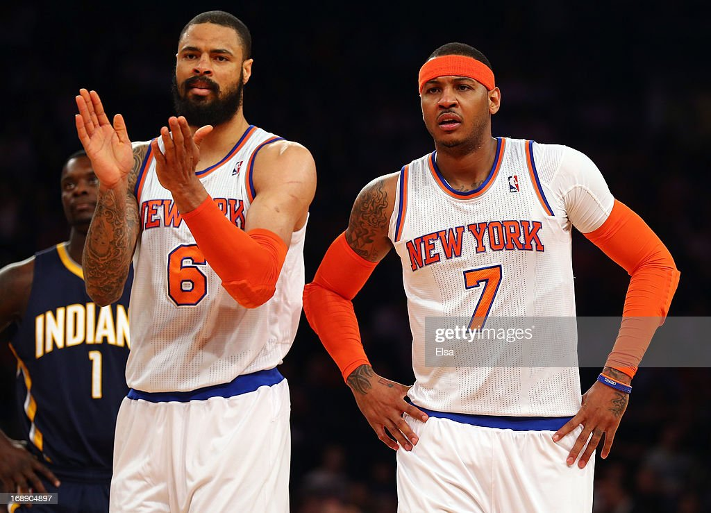 Tyson Chandler #6 of the New York Knicks and Carmelo Anthony #7 react after a play against Indiana Pacers during Game Five of the Eastern Conference Semifinals of the 2013 NBA Playoffs at Madison Square Garden on May 16, 2013 in New York City.
