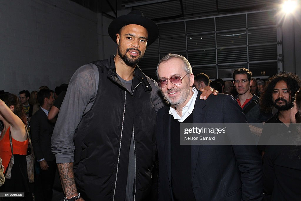 Tyson Chandler of the New York Knicks (L) and Jim Moore, GQ creative director attend The Best New Menswear Designers In America 2012 Party presented by GQ and GAP at Pier 40 Picnic House on September 18, 2012 in New York City.