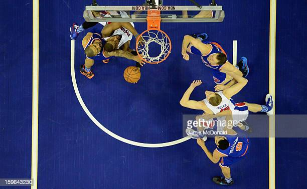 Tyson Chandler of the New York Knicks battles with Greg Monroe of Detroit Pistons during the NBA London Live 2013 game between New York Knicks and...