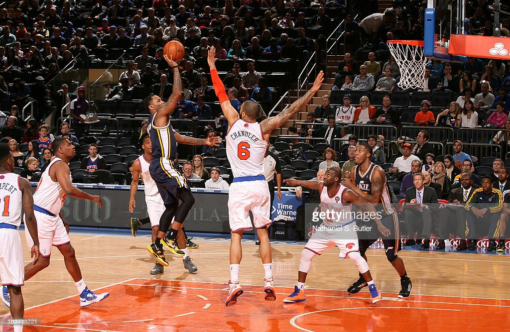 <a gi-track='captionPersonalityLinkClicked' href=/galleries/search?phrase=Tyson+Chandler&family=editorial&specificpeople=202061 ng-click='$event.stopPropagation()'>Tyson Chandler</a> #6 of the New York Knicks blocks Mo Williams #5 of the Utah Jazz on March 9, 2013 in a game between the Utah Jazz and the New York Knicks at Madison Square Garden in New York City.