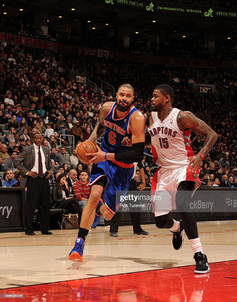 <a gi-track='captionPersonalityLinkClicked' href=/galleries/search?phrase=Tyson+Chandler&family=editorial&specificpeople=202061 ng-click='$event.stopPropagation()'>Tyson Chandler</a> #6 of the New York Knicks drives against the Toronto Raptors on December 28, 2013 at the Air Canada Centre in Toronto, Ontario, Canada.