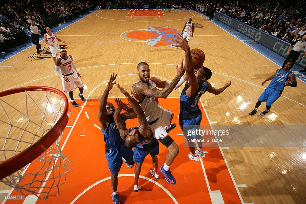 <a gi-track='captionPersonalityLinkClicked' href=/galleries/search?phrase=Tyson+Chandler&family=editorial&specificpeople=202061 ng-click='$event.stopPropagation()'>Tyson Chandler</a> #6 of the New York Knicks drives to the basket against the Dallas Mavericks during the game on November 9, 2012 at Madison Square Garden in New York City.
