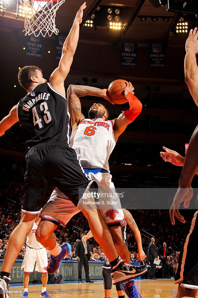 Tyson Chandler #6 of the New York Knicks drives to the basket against Kris Humphries #43 of the Brooklyn Nets on December 19, 2012 at Madison Square Garden in New York City.