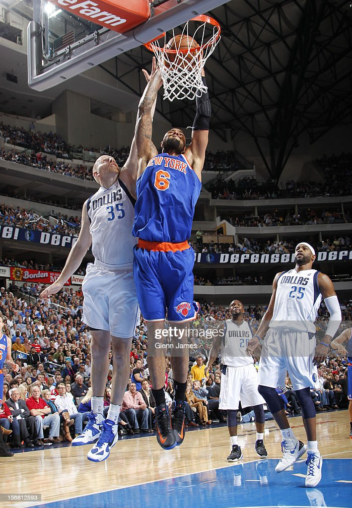 Tyson Chandler #6 of the New York Knicks dunks against Chris Kaman #35 of the Dallas Mavericks on November 21, 2012 at the American Airlines Center in Dallas, Texas.