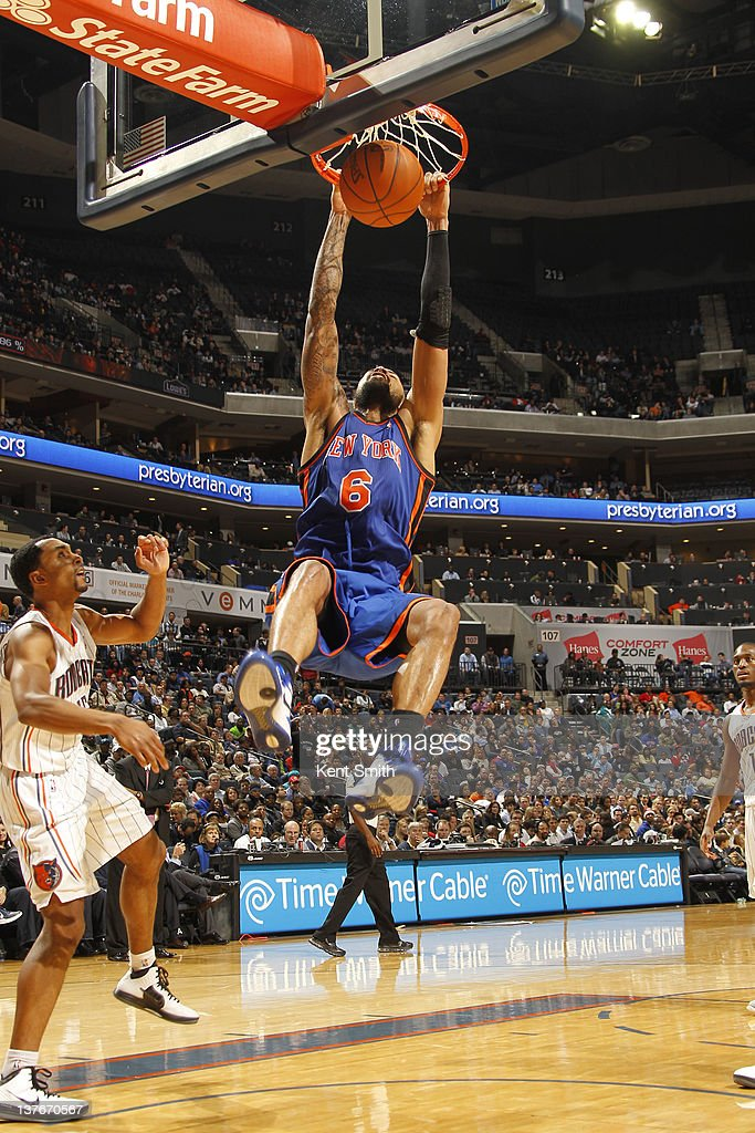 <a gi-track='captionPersonalityLinkClicked' href=/galleries/search?phrase=Tyson+Chandler&family=editorial&specificpeople=202061 ng-click='$event.stopPropagation()'>Tyson Chandler</a> #6 of the New York Knicks dunks against Derrick Brown #4 of the Charlotte Bobcats during the game at the Time Warner Cable Arena on January 24, 2012 in Charlotte, North Carolina.