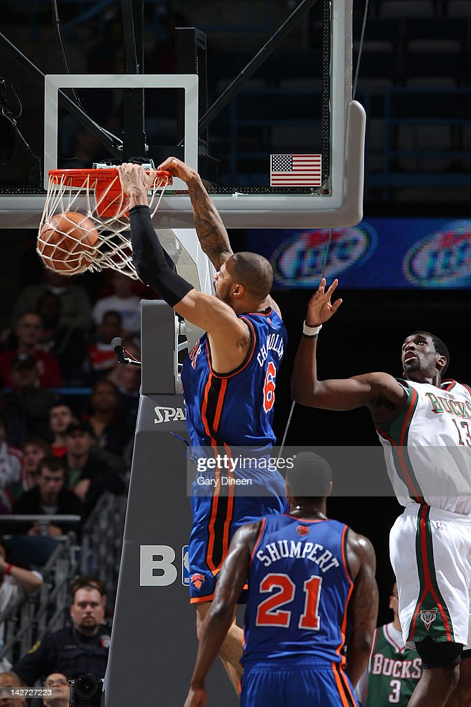 <a gi-track='captionPersonalityLinkClicked' href=/galleries/search?phrase=Tyson+Chandler&family=editorial&specificpeople=202061 ng-click='$event.stopPropagation()'>Tyson Chandler</a> #6 of the New York Knicks dunks against <a gi-track='captionPersonalityLinkClicked' href=/galleries/search?phrase=Ekpe+Udoh&family=editorial&specificpeople=4185351 ng-click='$event.stopPropagation()'>Ekpe Udoh</a> #13 of the Milwaukee Bucks on April 11, 2012 at the Bradley Center in Milwaukee, Wisconsin.