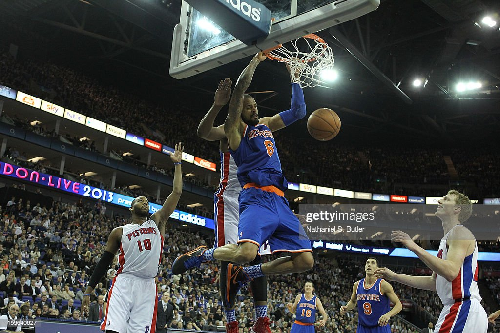 Tyson Chandler #6 of the New York Knicks dunks against Kyle Singler #25 of the Detroit Pistons and Greg Monroe #10 of the Detroit Pistons during a game between the New York Knicks and the Detroit Pistons at the 02 Arena on January 17, 2013 in London, England.