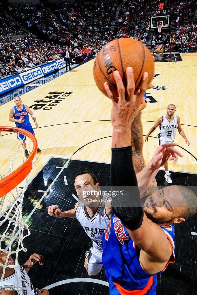 <a gi-track='captionPersonalityLinkClicked' href=/galleries/search?phrase=Tyson+Chandler&family=editorial&specificpeople=202061 ng-click='$event.stopPropagation()'>Tyson Chandler</a> #6 of the New York Knicks dunks against Manu Ginobili #20 of the San Antonio Spurs on November 15, 2012 at the AT&T Center in San Antonio, Texas.