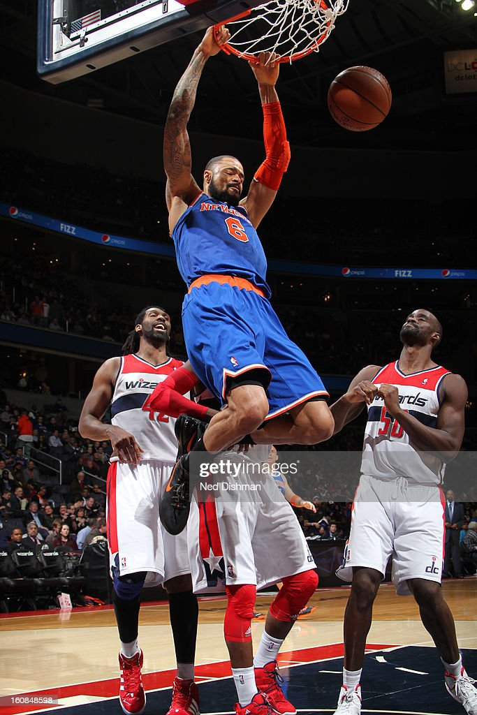 <a gi-track='captionPersonalityLinkClicked' href=/galleries/search?phrase=Tyson+Chandler&family=editorial&specificpeople=202061 ng-click='$event.stopPropagation()'>Tyson Chandler</a> #6 of the New York Knicks dunks against Nene #42 and <a gi-track='captionPersonalityLinkClicked' href=/galleries/search?phrase=Emeka+Okafor&family=editorial&specificpeople=201739 ng-click='$event.stopPropagation()'>Emeka Okafor</a> #50 of the Washington Wizards during the game at the Verizon Center on February 6, 2013 in Washington, DC.