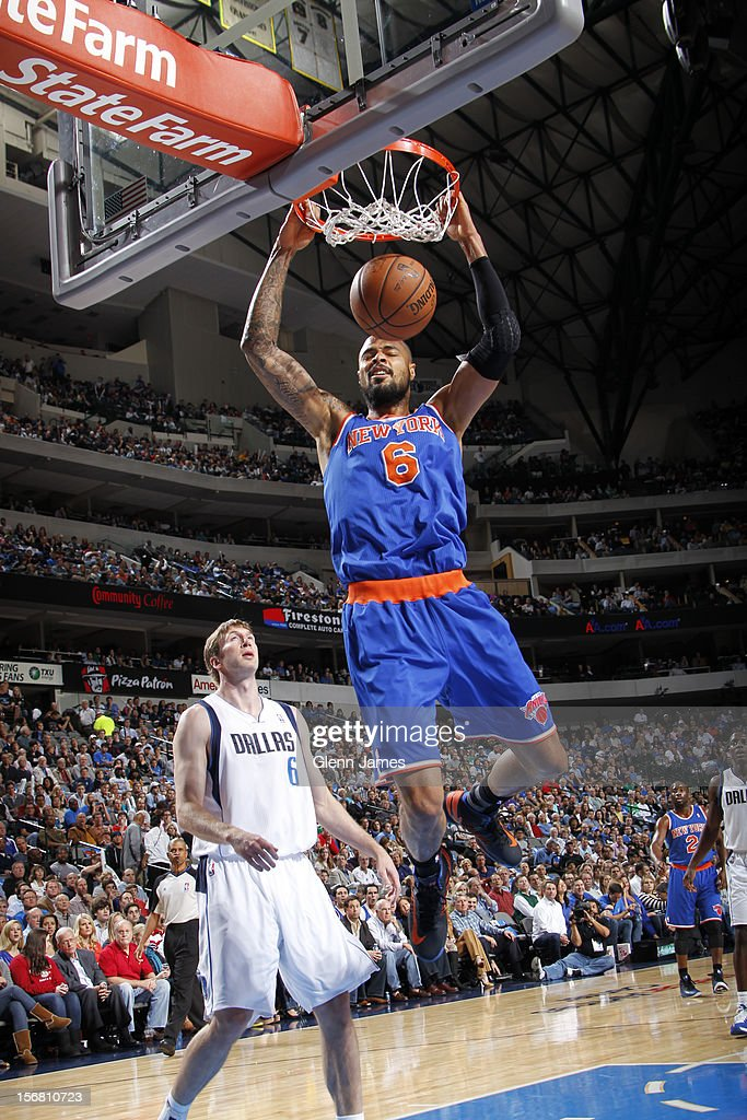 Tyson Chandler #6 of the New York Knicks dunks against Troy Murphy #6 of the Dallas Mavericks on November 21, 2012 at the American Airlines Center in Dallas, Texas.