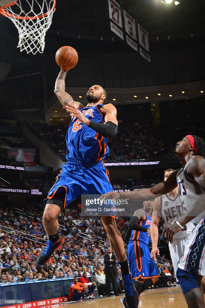 <a gi-track='captionPersonalityLinkClicked' href=/galleries/search?phrase=Tyson+Chandler&family=editorial&specificpeople=202061 ng-click='$event.stopPropagation()'>Tyson Chandler</a> #6 of the New York Knicks dunks over <a gi-track='captionPersonalityLinkClicked' href=/galleries/search?phrase=Gerald+Wallace&family=editorial&specificpeople=202117 ng-click='$event.stopPropagation()'>Gerald Wallace</a> #45 of the New Jersey Nets on April 18, 2012 at the Prudential Center in Newark, New Jersey.