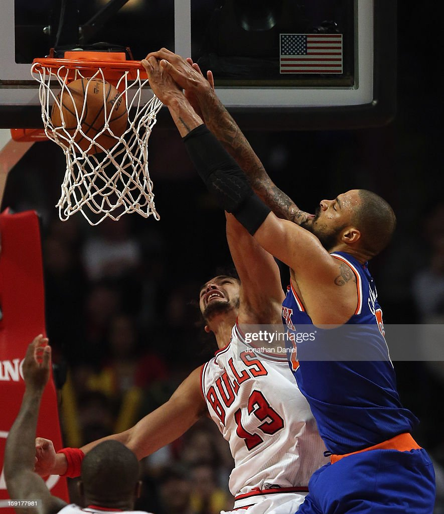 <a gi-track='captionPersonalityLinkClicked' href=/galleries/search?phrase=Tyson+Chandler&family=editorial&specificpeople=202061 ng-click='$event.stopPropagation()'>Tyson Chandler</a> #6 of the New York Knicks dunks over <a gi-track='captionPersonalityLinkClicked' href=/galleries/search?phrase=Joakim+Noah&family=editorial&specificpeople=699038 ng-click='$event.stopPropagation()'>Joakim Noah</a> #13 of the Chicago Bulls at the United Center on December 8, 2012 in Chicago, Illinois. The Bulls defeated the Knicks 93-85.