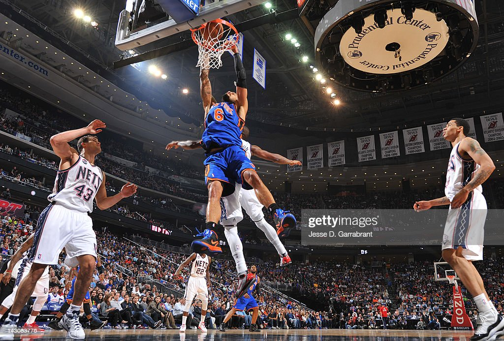 <a gi-track='captionPersonalityLinkClicked' href=/galleries/search?phrase=Tyson+Chandler&family=editorial&specificpeople=202061 ng-click='$event.stopPropagation()'>Tyson Chandler</a> #6 of the New York Knicks dunks over <a gi-track='captionPersonalityLinkClicked' href=/galleries/search?phrase=Kris+Humphries&family=editorial&specificpeople=209199 ng-click='$event.stopPropagation()'>Kris Humphries</a> #43 of the New Jersey Nets on April 18, 2012 at the Prudential Center in Newark, New Jersey.