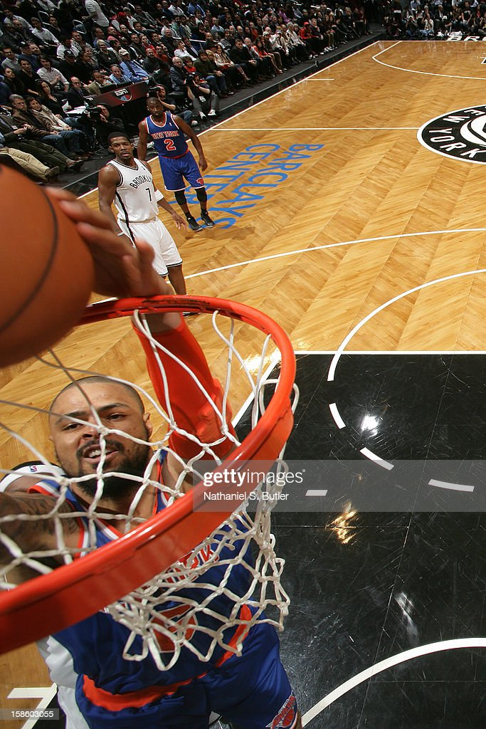 Tyson Chandler #6 of the New York Knicks dunks the ball against the Brooklyn Nets on December 11, 2012 at the Barclays Center in the Brooklyn borough of New York City.