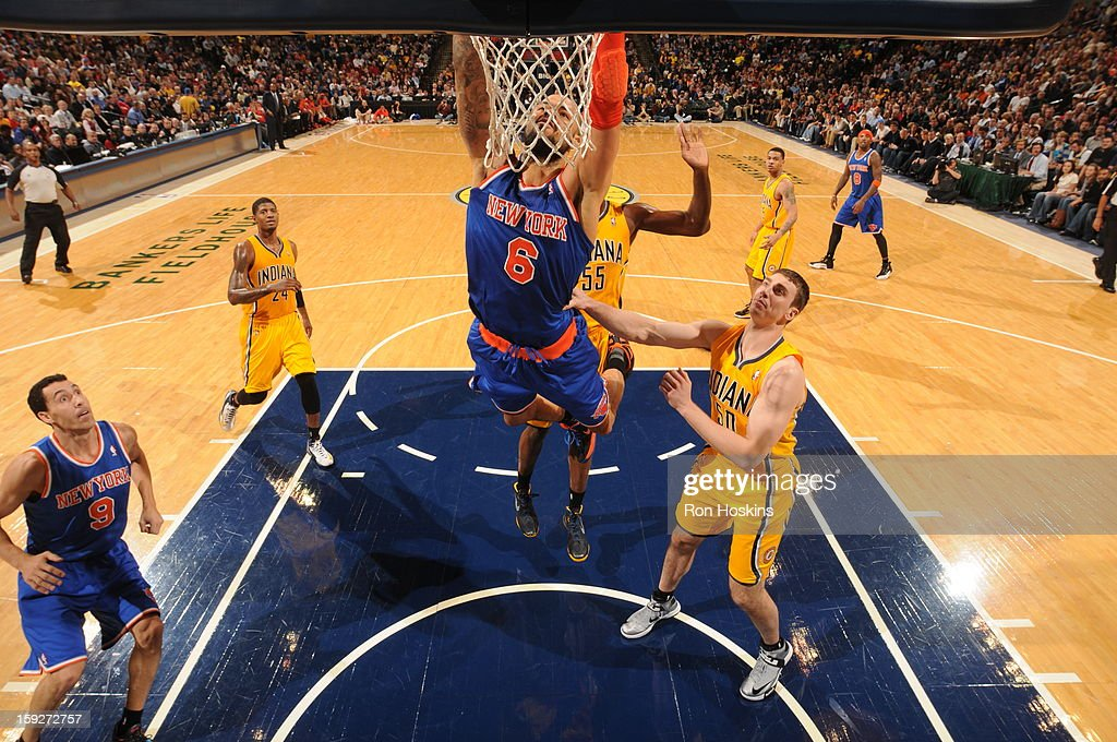 <a gi-track='captionPersonalityLinkClicked' href=/galleries/search?phrase=Tyson+Chandler&family=editorial&specificpeople=202061 ng-click='$event.stopPropagation()'>Tyson Chandler</a> #6 of the New York Knicks dunks the ball against the Indiana Pacers on January 10, 2013 at Bankers Life Fieldhouse in Indianapolis, Indiana.