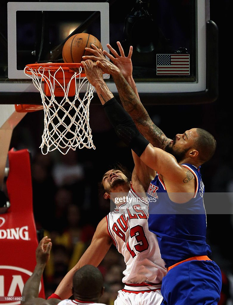 <a gi-track='captionPersonalityLinkClicked' href=/galleries/search?phrase=Tyson+Chandler&family=editorial&specificpeople=202061 ng-click='$event.stopPropagation()'>Tyson Chandler</a> #6 of the New York Knicks dunks the ball over <a gi-track='captionPersonalityLinkClicked' href=/galleries/search?phrase=Joakim+Noah&family=editorial&specificpeople=699038 ng-click='$event.stopPropagation()'>Joakim Noah</a> #13 of the Chicago Bulls at the United Center on December 8, 2012 in Chicago, Illinois. The Bulls defeated the Knicks 93-85.