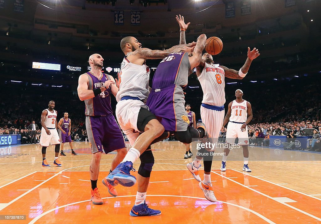 Tyson Chandler #6 of the New York Knicks fouls Shannon Brown #26 of the Phoenix Suns at Madison Square Garden on December 2, 2012 in New York City.
