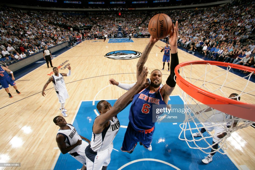 Tyson Chandler #6 of the New York Knicks goes in for the dunk against Elton Brand #42 of the Dallas Mavericks on November 21, 2012 at the American Airlines Center in Dallas, Texas.