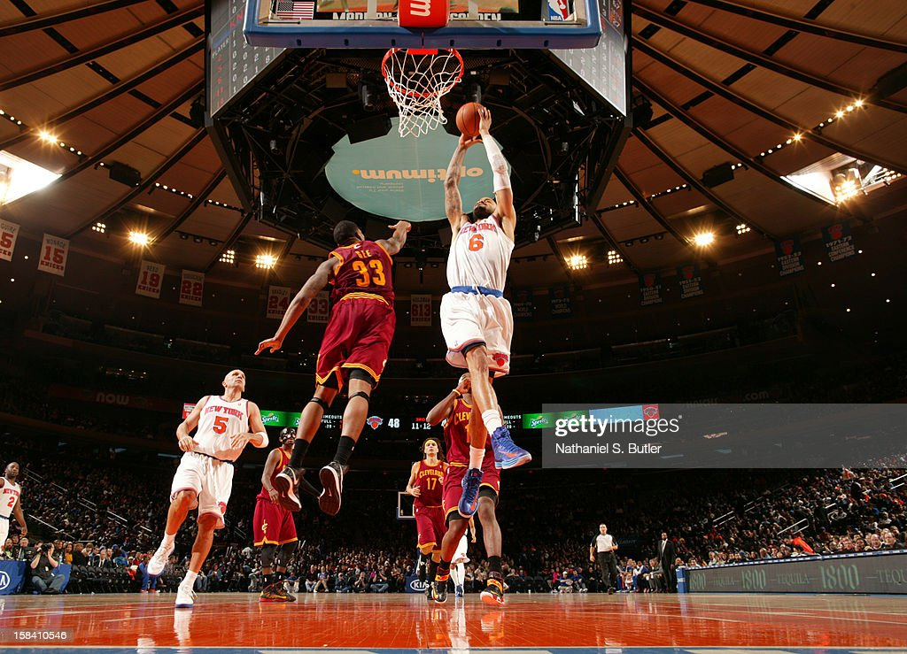 <a gi-track='captionPersonalityLinkClicked' href=/galleries/search?phrase=Tyson+Chandler&family=editorial&specificpeople=202061 ng-click='$event.stopPropagation()'>Tyson Chandler</a> #6 of the New York Knicks goes to the basket against Alonso Gee #33 of the Cleveland Cavaliers during game on December 15, 2012 at Madison Square Garden in New York City.