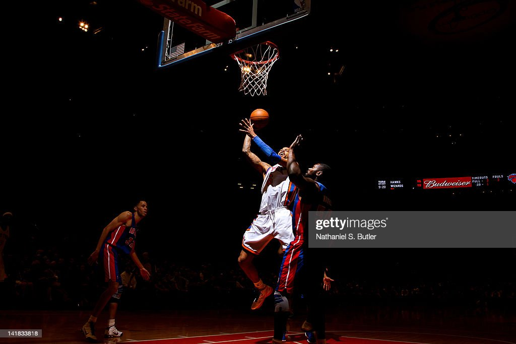 <a gi-track='captionPersonalityLinkClicked' href=/galleries/search?phrase=Tyson+Chandler&family=editorial&specificpeople=202061 ng-click='$event.stopPropagation()'>Tyson Chandler</a> #6 of the New York Knicks goes to the basket against <a gi-track='captionPersonalityLinkClicked' href=/galleries/search?phrase=Jason+Maxiell&family=editorial&specificpeople=651723 ng-click='$event.stopPropagation()'>Jason Maxiell</a> #54 of the Detroit Pistons on March 24, 2012 at Madison Square Garden in New York City.
