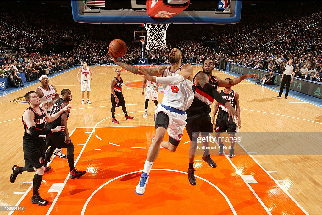 <a gi-track='captionPersonalityLinkClicked' href=/galleries/search?phrase=Tyson+Chandler&family=editorial&specificpeople=202061 ng-click='$event.stopPropagation()'>Tyson Chandler</a> #6 of the New York Knicks goes up against <a gi-track='captionPersonalityLinkClicked' href=/galleries/search?phrase=LaMarcus+Aldridge&family=editorial&specificpeople=453277 ng-click='$event.stopPropagation()'>LaMarcus Aldridge</a> #12 of the Portland Trail Blazers on January 1, 2013 at Madison Square Garden in New York City.