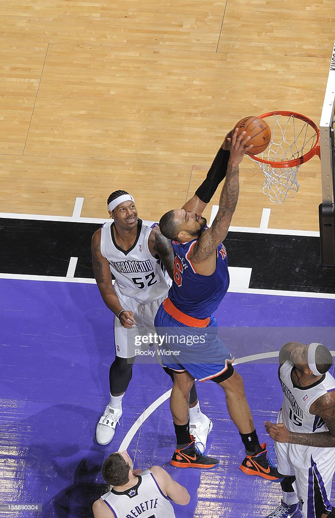<a gi-track='captionPersonalityLinkClicked' href=/galleries/search?phrase=Tyson+Chandler&family=editorial&specificpeople=202061 ng-click='$event.stopPropagation()'>Tyson Chandler</a> #6 of the New York Knicks goes up for the dunk against James Johnson #52 and <a gi-track='captionPersonalityLinkClicked' href=/galleries/search?phrase=DeMarcus+Cousins&family=editorial&specificpeople=5792008 ng-click='$event.stopPropagation()'>DeMarcus Cousins</a> #15 of the Sacramento Kings on December 28, 2012 at Sleep Train Arena in Sacramento, California.