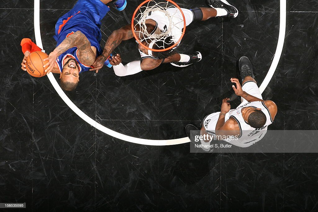 <a gi-track='captionPersonalityLinkClicked' href=/galleries/search?phrase=Tyson+Chandler&family=editorial&specificpeople=202061 ng-click='$event.stopPropagation()'>Tyson Chandler</a> #6 of the New York Knicks grabs a rebound against the Brooklyn Nets on November 26, 2012 at the Barclays Center in the Brooklyn Borough of New York City.