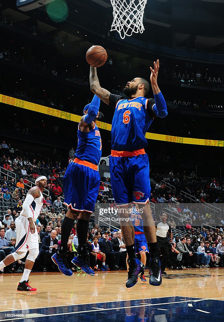 Tyson Chandler #6 of the New York Knicks grabs a rebound against the Atlanta Hawks on April 3, 2013 at Philips Arena in Atlanta, Georgia.