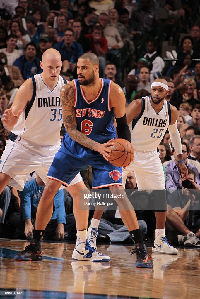 Tyson Chandler #6 of the New York Knicks posts up against Chris Kaman #35 of the Dallas Mavericks on November 21, 2012 at the American Airlines Center in Dallas, Texas.