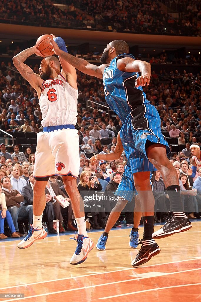 Tyson Chandler #6 of the New York Knicks protects the ball during the game between the New York Knicks and the Orlando Magic on January 30, 2013 at Madison Square Garden in New York City .