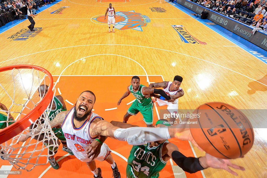 Tyson Chandler #6 of the New York Knicks reaches for a rebound against Paul Pierce #34 of the Boston Celtics in Game Five of the Eastern Conference Quarterfinals during the 2013 NBA Playoffs on May 1, 2013 at Madison Square Garden in New York City.