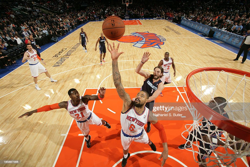 <a gi-track='captionPersonalityLinkClicked' href=/galleries/search?phrase=Tyson+Chandler&family=editorial&specificpeople=202061 ng-click='$event.stopPropagation()'>Tyson Chandler</a> #6 of the New York Knicks reaches for a rebound during a preseason game against the Charlotte Bobcats on October 25, 2013 at Madison Square Garden in New York City.